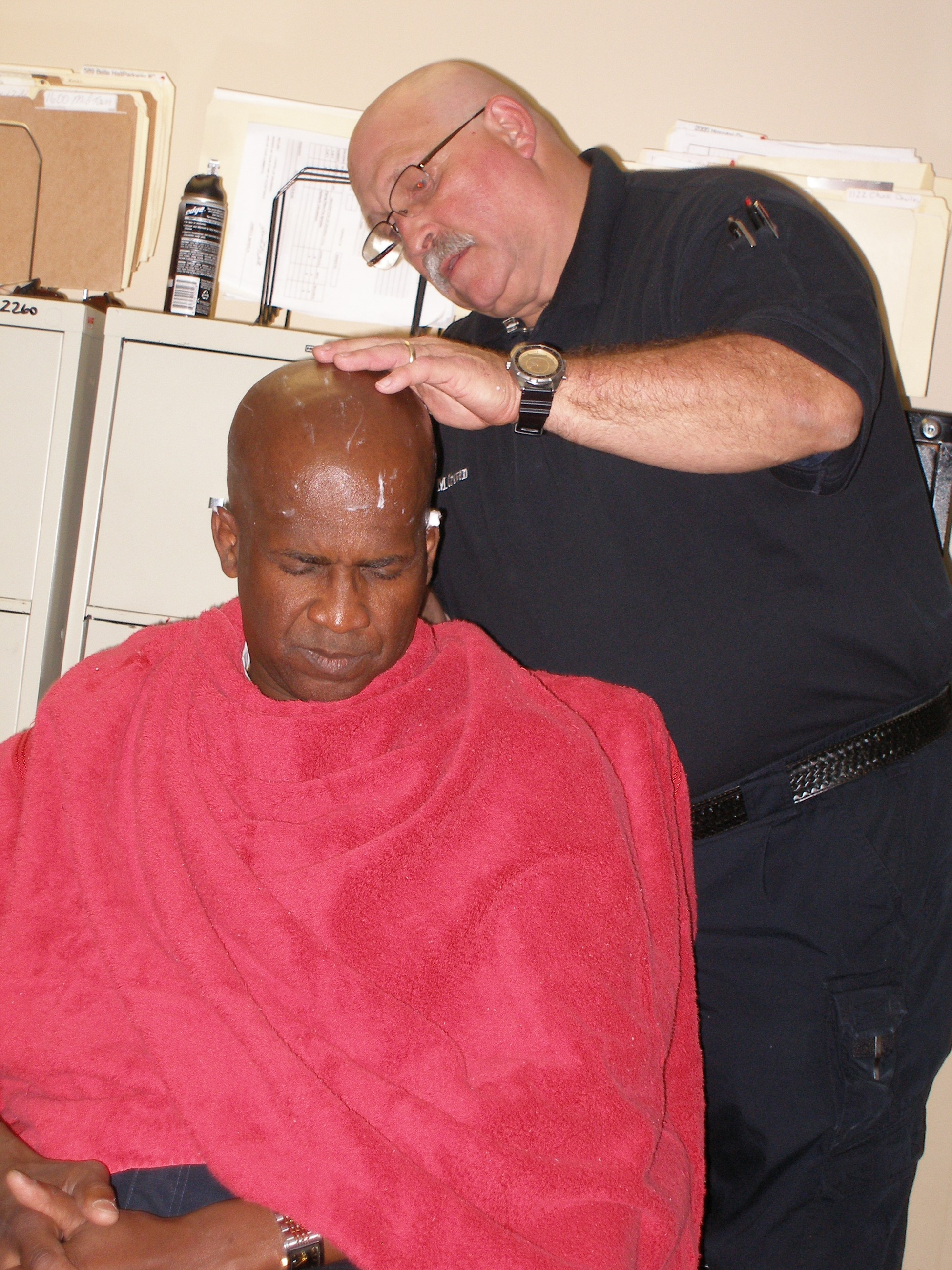 Mitch Craven shaving Chief Williams